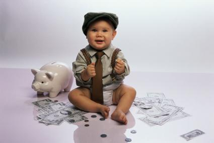 Baby counting piggybank money