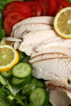 Sliced chicken with salad