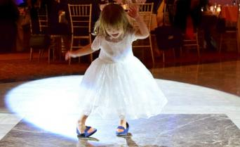 toddler girl dancing at wedding