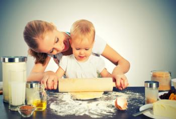 mom baking with toddler