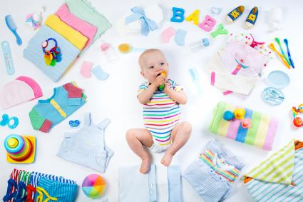 Little baby with infant care items