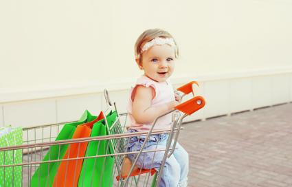 Baby sitting in shopping cart