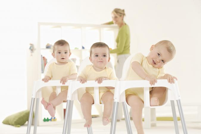 babies sitting in high chairs