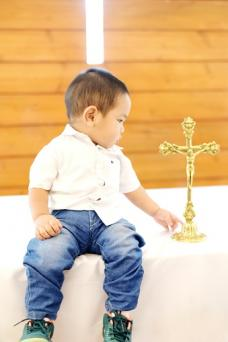 Baby Boy Looking At Cross