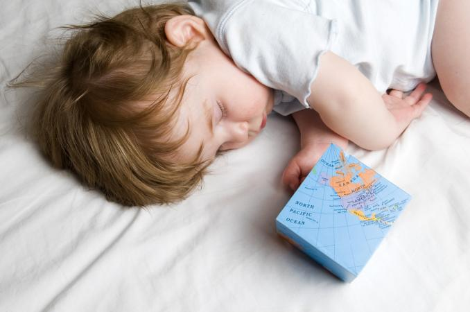 Sleeping Baby with Globe