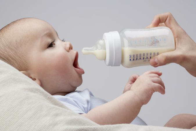 A baby being fed by bottle