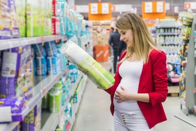Pregnant woman buying diapers