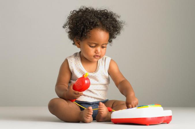 Baby playing with toy phone