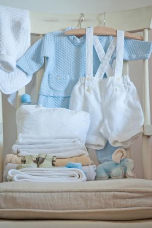 Baby clothing in rocking chair