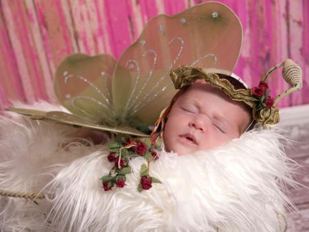 Newborn baby dressed like a fairy