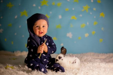 Baby with rabbit in star outfit