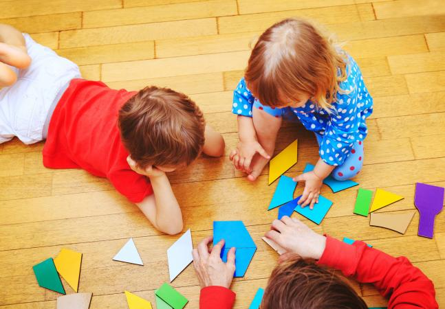 Kids playing with shape cutouts