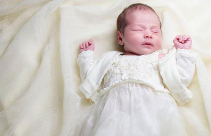 newborn baby in christening gown