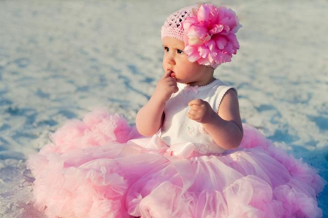 baby girl in pink pageant dress