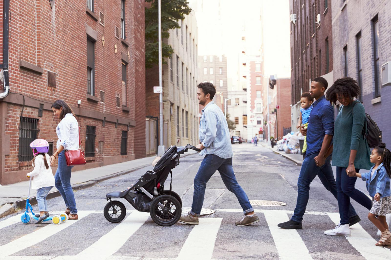 Two families with kids crossing road