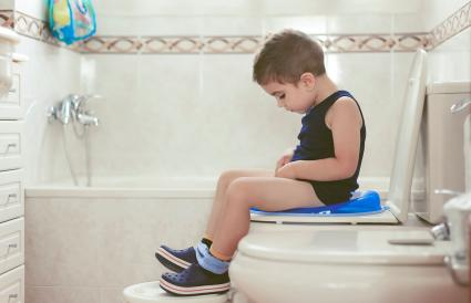 Boy sitting on a potty chairs