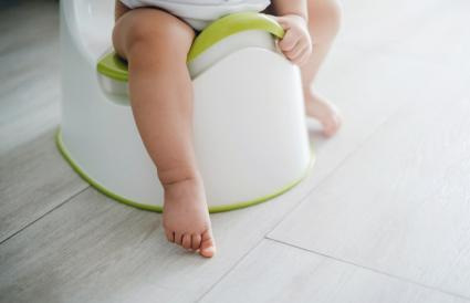toddler sitting on a potty chair