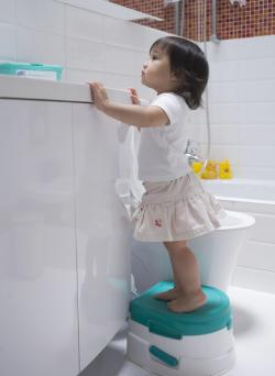 Child standing on potty