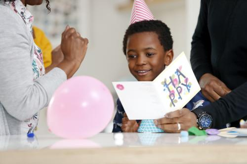 Boy receiving birthday card