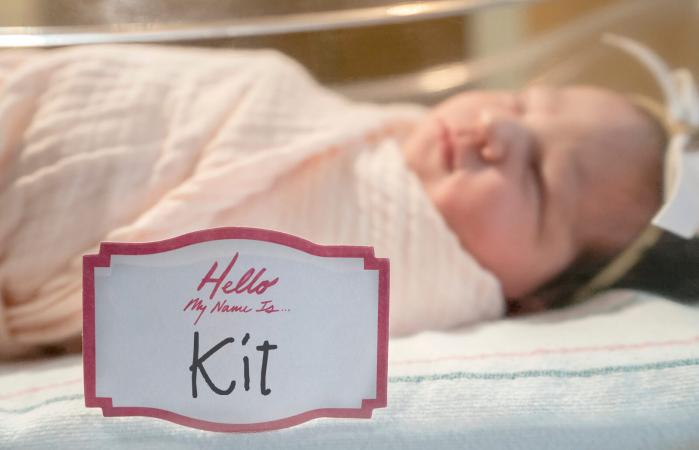 newborn baby girl with tag
