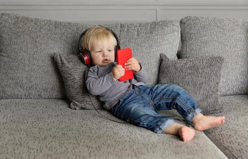 Toddler lying on couch