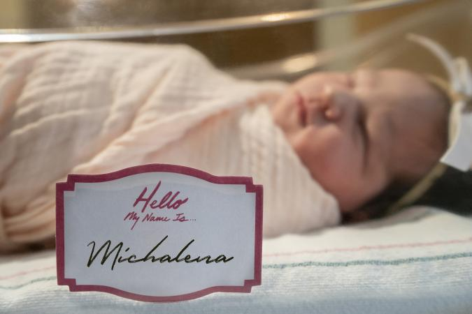 newborn baby girl with name tag