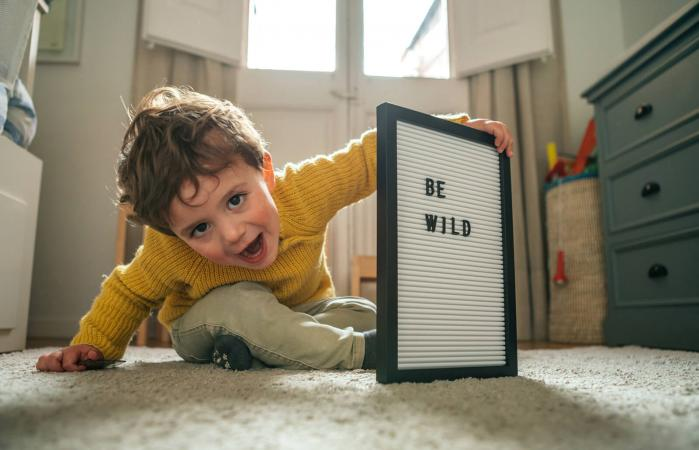 "Little boy with ""Be Wild"" text"