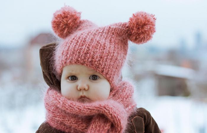 Little Girl Wearing a Hat and Scarf