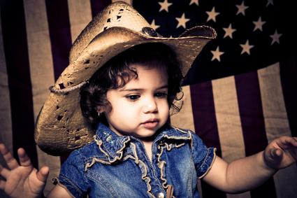 Cute kid wearing cowboy hat