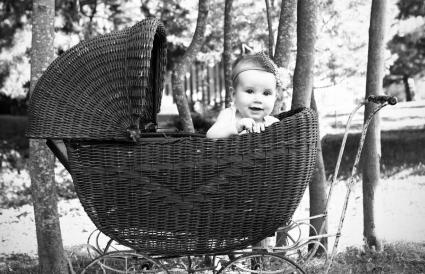 baby girl in an antique pram