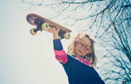 Young girl on a skateboard