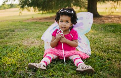 baby girl in fairy costume in park