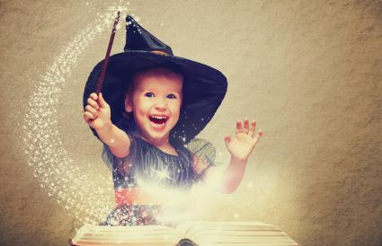 cheerful little witch with a magic