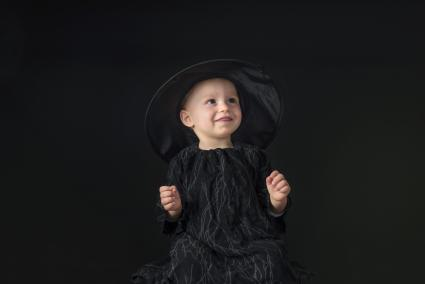 Little halloween witch on black