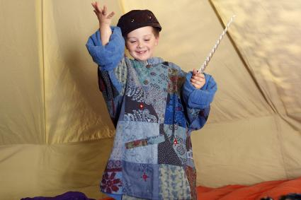 Young boy dressed as a wizard