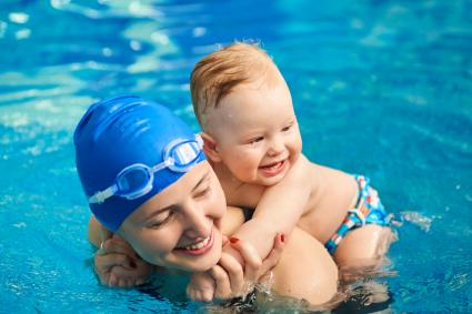 Child having fun in water with mom