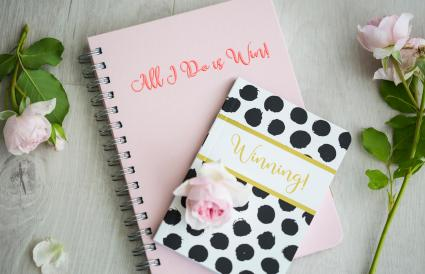 Fresh pink roses with two notebooks