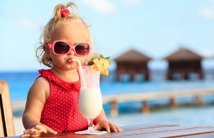 little girl drinking frozen slush