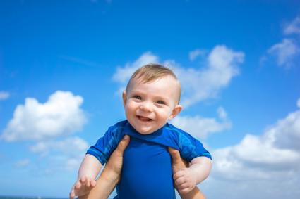 Baby boy against blue sky