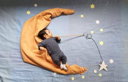 Baby boy with star decorations