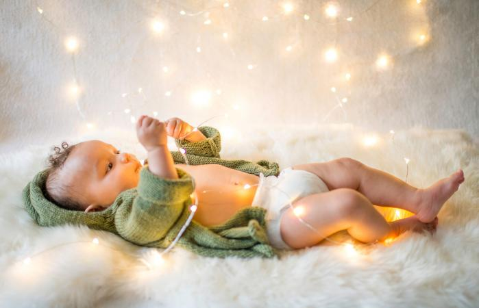Baby boy playing with decorative lights