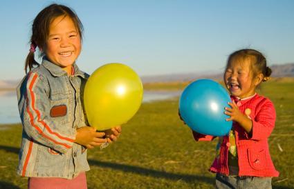 Little girls holing balloons