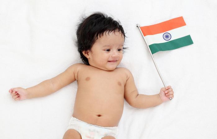 baby boy holding Indian flag