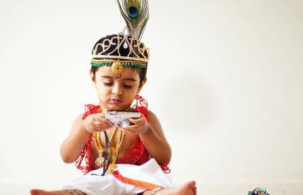 Boy dressed as Lord Krishna