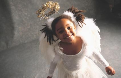 girl smiling in angel costume