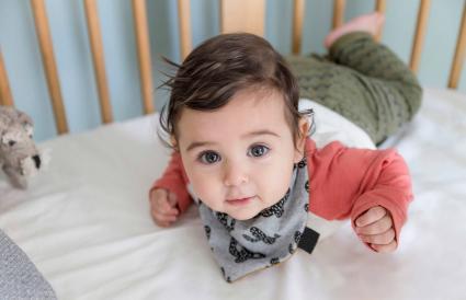 baby lying in the crib