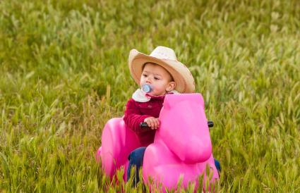 baby girl playing at countryside