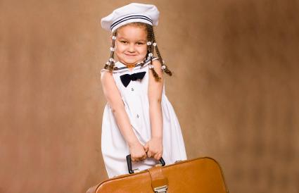 little girl with vintage suitcase