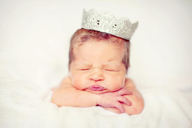 Newborn baby wearing a silver crown
