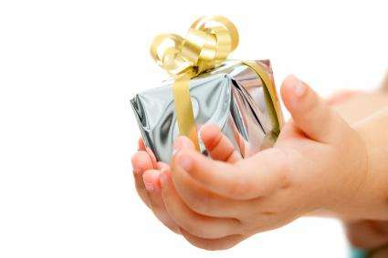 Babies hands holding small present